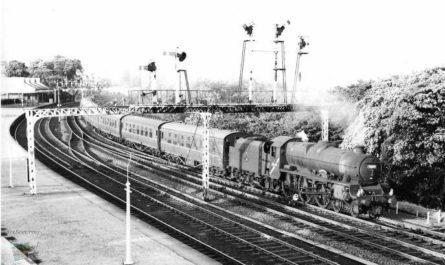 Train Passing Under Signal Gantry